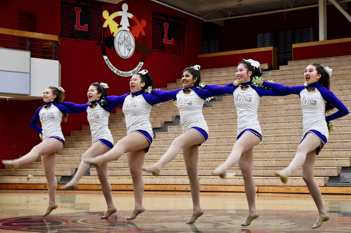 The song team performs at James Logan HS on December 2. Their goal for this performance, according to senior captain Madi Anderson-Au, was to gain experience and improve their routine using feedback from the judges. Photo by Om Khandekar.