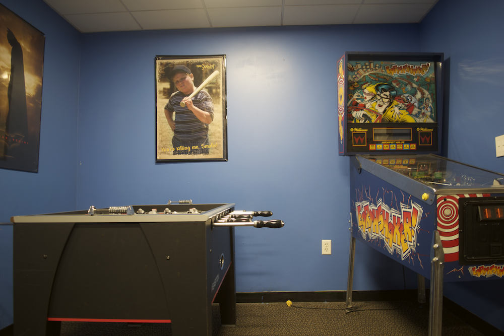 Among other activities, the Teen Center offers foosball and 1990s-based video game, called Earth Shaker. Photo by Sunjin Chang.