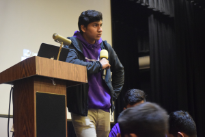 President and senior Ishan Mitra speaks in the auditorium. Photo by Nate Stevens