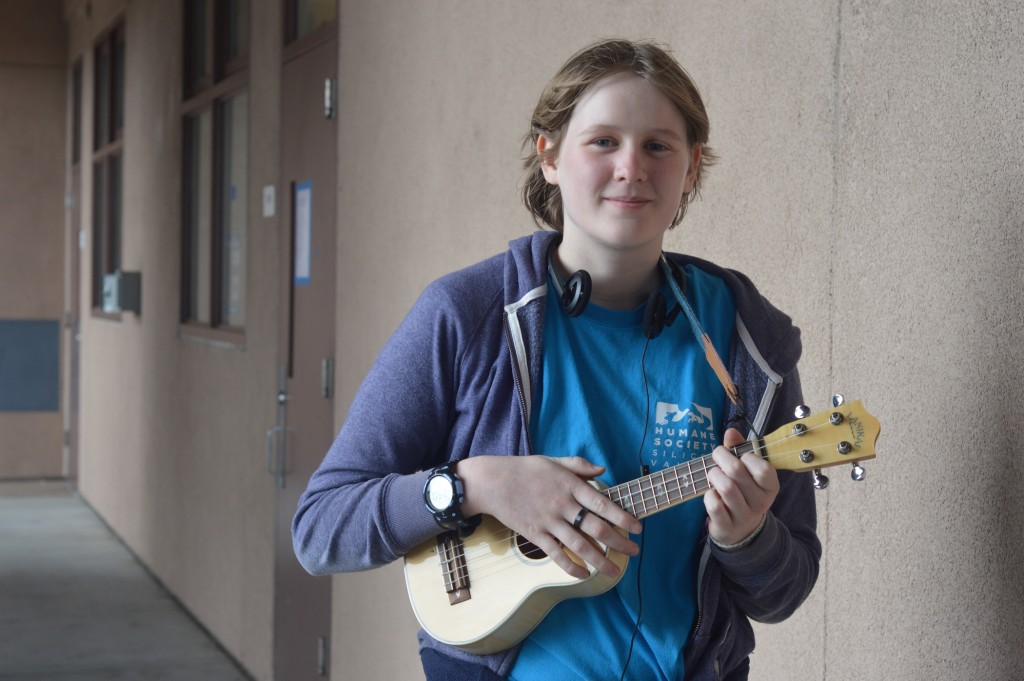 Gregory holds her ukulele. She typically plays at the D building during fifth period and lunch. Photo by Helen Chao.