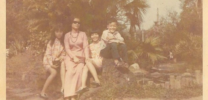 Tu Gustafson, pictured on the very left, sits with her mother and siblings in a Vietnamese garden. The family lived in Vietnam until the fall of Saigon in 1975.