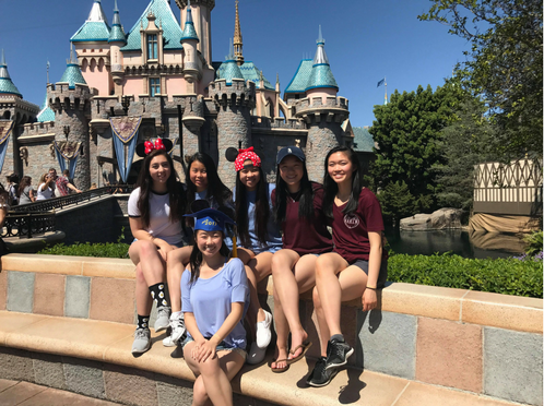 Law (center) with other dance team members at Disneyland. Since Nationals is in Anaheim, Calif., the dancers get to visit Disneyland. Photo used with permission of Sabina Law.